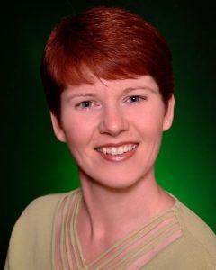 Headshot of Julie Rowe for Book Brush blog on Audio Narrators